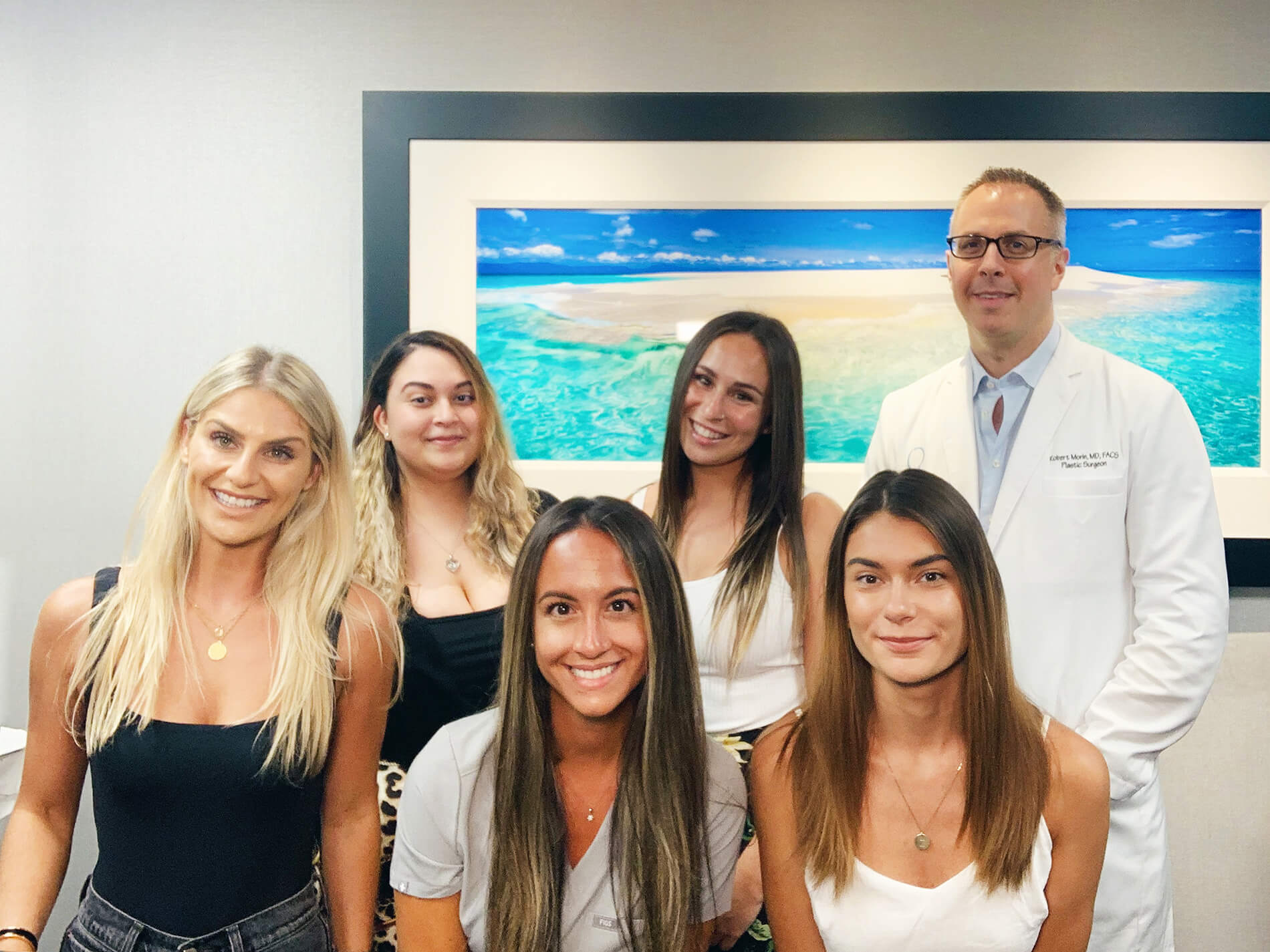 Robert Morin MD with beautiful smiling woman's team