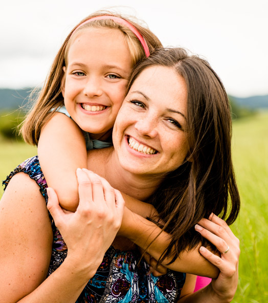 Mommy Makeover - smiling female with daughter