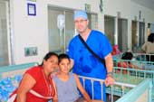Surgical Mission: little girl after operation with Dr. Morin in viewing room